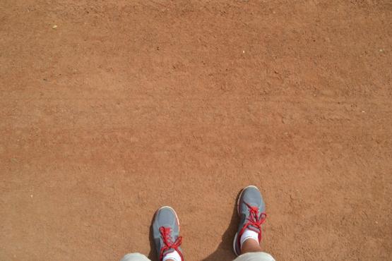 malcolm-on-field-at-globe-life-park-feet